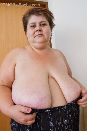 Lewd mature bbw showing off her large breasts