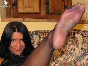 Dark haired pantyhose feet