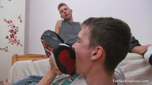 Sexy guy sucks feet