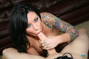 Smoking hot lady with huge tits sucks a huge cock.