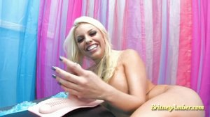 Tanned blue-eyed blonde riding a sybian on camera