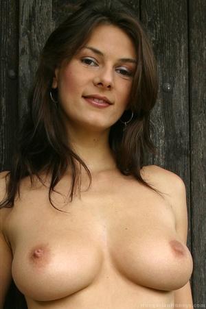 Blue get-up brunette shows her holes outdoors