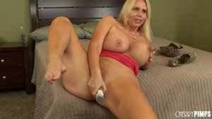 Stunning milf with blonde hair is fucking hard in living room