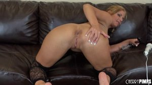 Horny big-titted slut with blonde hair is drilling her pussy with a toy