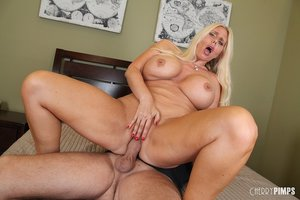 Blonde angel with big tits is riding cock while wearing sexy bra
