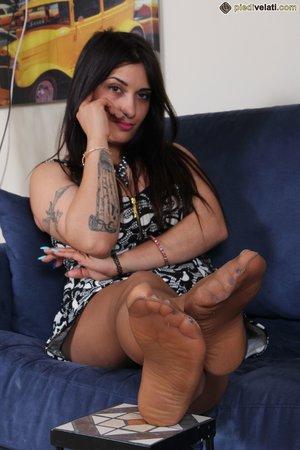 Brunette feet soles