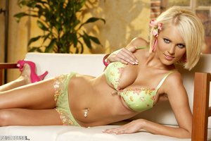 Blonde bombshell teases with her indulging body in green and multi colored floral underwear and red purple high heels before she takes off her bra and releases her huge boobs then pulls down her panty and shows her sweet pussy in different poses on a