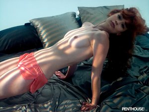 Luscious redhead displays her indulging body in different poses wearing her red lingerie then shows her sweet tits before she gets naked and reveals her juicy pussy in different poses on a blue couch.