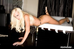 Stunning blonde reveals her luscious boobs and sweet pussy as she displays her indulging body in different poses wearing her black beads blouse and high heels on a white bed.
