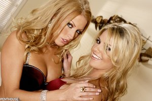 Foxy blondes teases with their banging bodies in different poses wearing their maroon underwear before they peel off their bra and lick each others tits then strips down their panties and reveal their twats on a white couch.