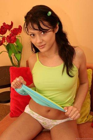 Skinny angel is wearing sweet white panties while drilling herself in living room