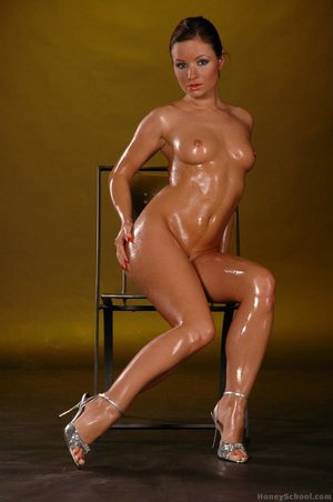 Charming brunette babe oiled