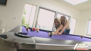 Horny blonde lesbian milf teaches young busty blonde how to play pool and plays with sex toys on the table