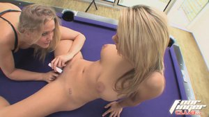Lesbian blonde momma wearing black bra takes advantages of young busty blonde with hip tattoos on the purple billards table