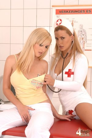 Slutty nurse in tight white latex uniform inspects young blonde patient on the red hospital bed