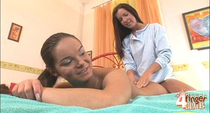 Skinny brunette friends oils each other's bodies and enjoys sensual massage on the colorful bed