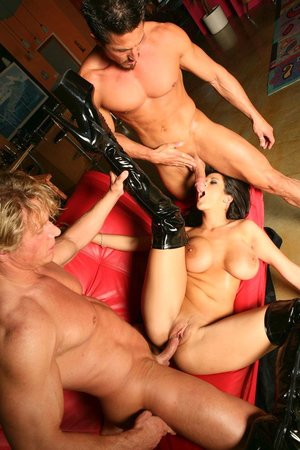 Big-titted bimbo is wearing sexy leather boots while having hot threesome