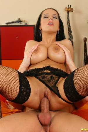 Sexy big-titted lassie with dark hair is playing with big cock