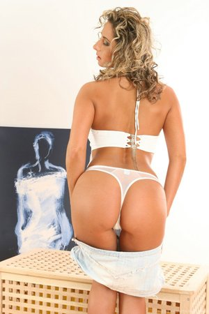 Blonde hair tossed back she shows off her deep throating skills on her toy