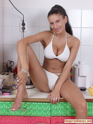 Sitting kitchen floor brunette