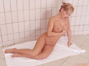 Wearing only a white towel this blonde shows off her hot body for her fans