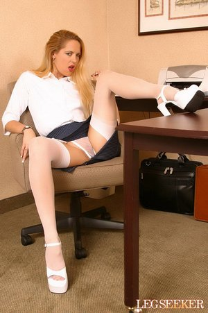 Alluring girl with blonde hair is playing with her clit in office