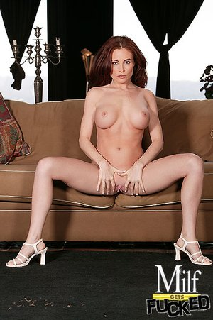 Nice milf with red hair is seen giving a hot blowjob