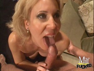 Blonde bitch with nice tits is licking cock then rides it in the living room