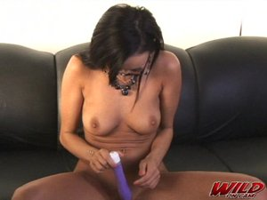 Skinny model rams a vibrating purple toy deep insider her pink pussy