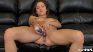 Brunette country girl jams a toy deep inside herself on black leather couch