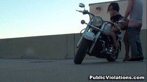 On a rooftop, he bends her over his hog, driving deep into her warmth