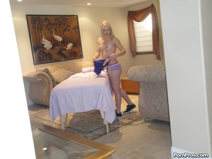 Tatted, with golden lock, she gets splashed with cum after a deep tissue massage