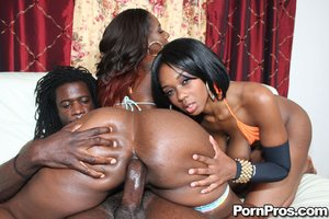 Dark skinned, with big tits, she takes his ebony cock deep inside her anus