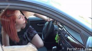 Hooking up in a car, this redhead makes out before mounting her man, taking him deep