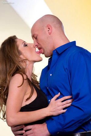 A bald stud, fucks brunette doggy style, driving his raw cock deep
