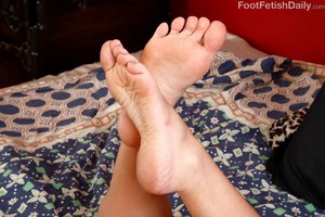 Interracial reverse footjob